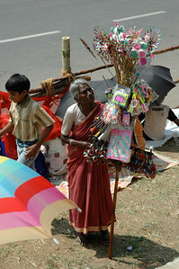 Many vendors work the crowd waiting for the Dasara parade in Mysore.