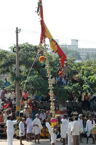The men dance with this huge pole, um, right. Dasara parade in Mysore.