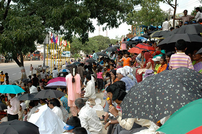 The stands are full well before the parade arrives; Dasara parade route in Mysore.