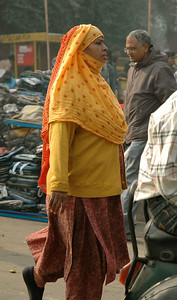 Woman on streets of Old Delhi.