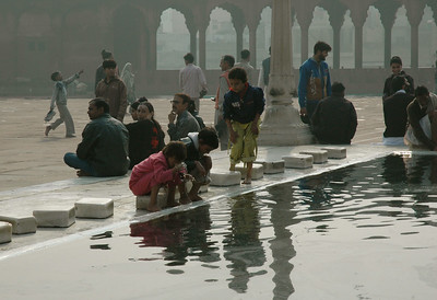 People around the reflecting pool, Jama Masjid mosque. [Delhi]