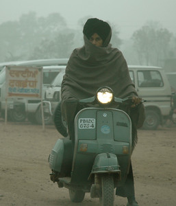 bundled against the chill and the dust. Dharamsala to Delhi. Punjab.