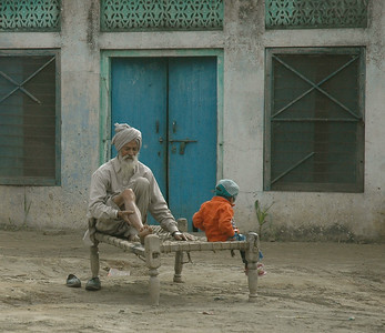 a villager and his grandson, on a bed beside the road? Himachal Pradesh. Punjab.