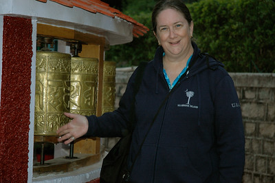 Pam spins the prayer wheels in Dharamsala.