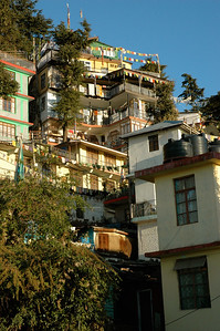 Dharamsala clings to the steep hillside, with narrow streets and multistory buildings.