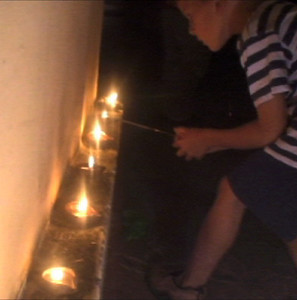 (IISc): Andy lights his sparkler from a diya at Sonali's house, on Diwali night.