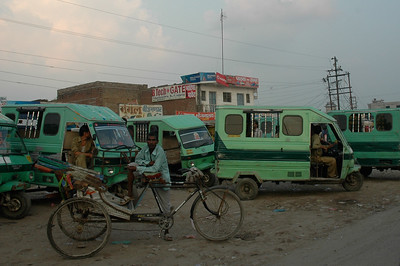 Rickshaws wait for customers on the streets of Kanpur.