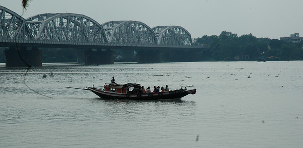 Seen from Dakshineswar Kali Temple, a boat on the Hooghly River. Kolkata.