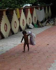 at Dakshineswar Kali Temple, there were many beggars around, along with their children. Kolkata.