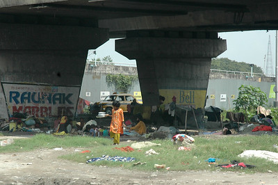 "Many people live under the ""flyovers"" of the new roads. Kolkata."