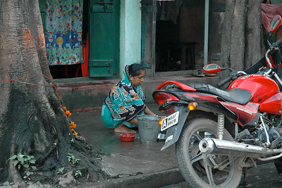 Washing pots on the sidewalk; Kolkata.