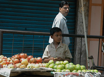 A boy minding the fruit stand; Kolkata.