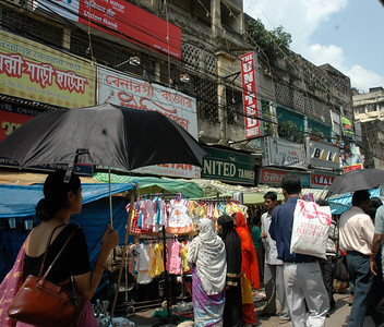 the street is packed with shoppers; Kolkata.