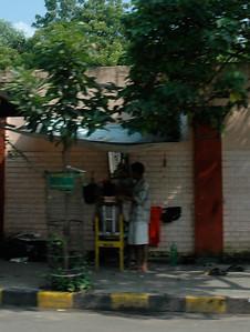 A sidewalk barbershop; Kolkata.