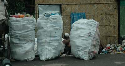 These men were collecting recyclable plastic from trash.