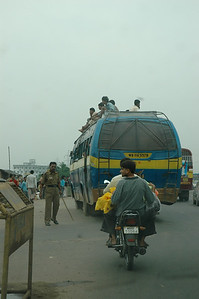I saw many buses, all full, often with passengers on top.