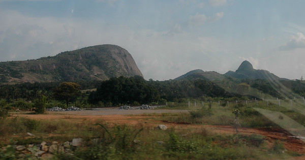 Between Bangalore and Mysore the terrain is flat, with occasional granite outcroppings.