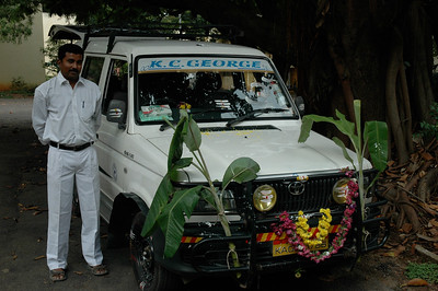 Ramesh picks us up for a weekend trip to Mysore.