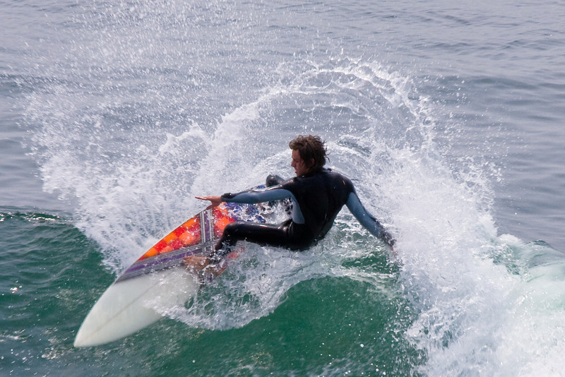 Surfing at Santa Cruz near lighthouse.