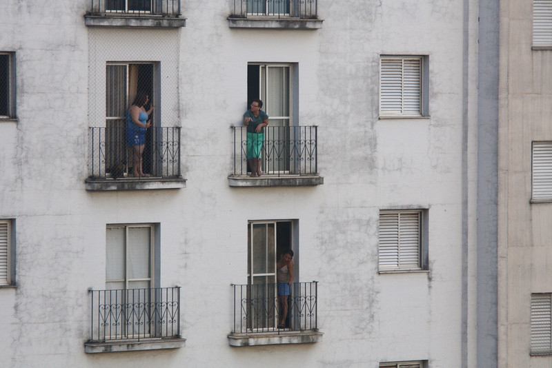 View of apartment building accross from Hotel Mercure Campinas. Neighbourhood gossipping and conversation.