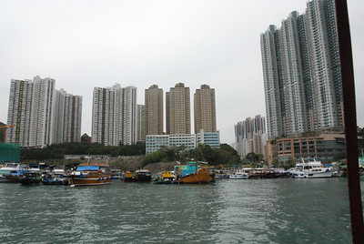 Aberdeen fishing village sits at the foot of the skyscrapers.