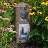 An original concrete marker of The Lincoln Highway, the first paved highway across the USA. The highway was begun in 1913, In 1928 the Boy Scouts placed nearly 3000 of these concrete markers along the highway. This one is in the square in New Oxford, PA where I live.