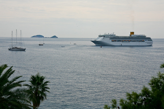 Cruise ship with 2-3 thousand passengers on right.<br /> Panorama on left 38 passengers