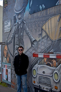 Chris leaning on the Berlin Wall