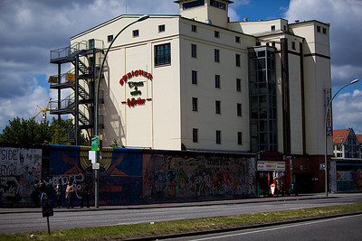 Berlin Wall with hotel behind it.