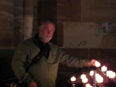 Rex Lighting a candle in the Strasbourg Cathedral