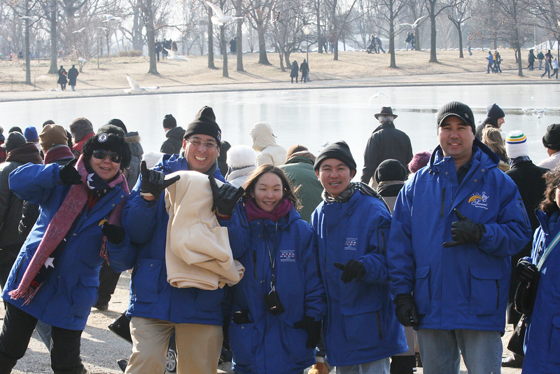 Seawind Tours and Travel staff and Punahou faculty pose at the National Mall before the inauguration of Barack Obama in Washington, D.C. on January 20, 2009.