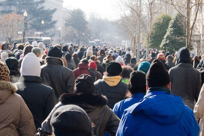 Millions of people walk along the streets of Washington, D.C., on their way to the National Mall to attend the inauguration of Barack Obama on January 20, 2009.