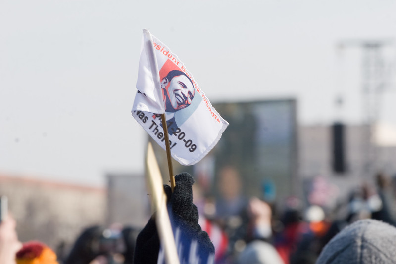 "An attendee of the inauguration of President Barack Obama holds an ""I was there!"" flag on January 20, 2009, in Washington, D.C."