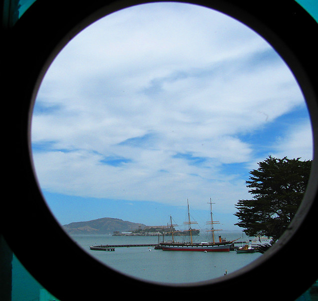 View of Alcatraz in San Francisco Bay from restaurant in Ghirardelli Square.