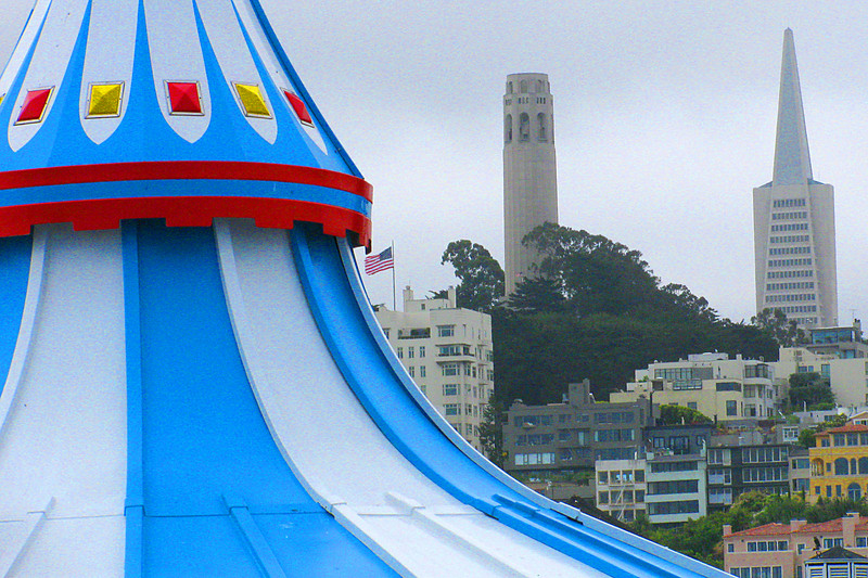 Landmarks: Coit tower on Telegraph Hill and the Transamerica Building seen from Fisherman's Wharf.