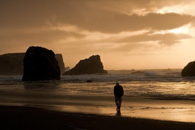 Solo walker at sunset, Bandon Beach