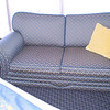 Sofa bed in front of windows