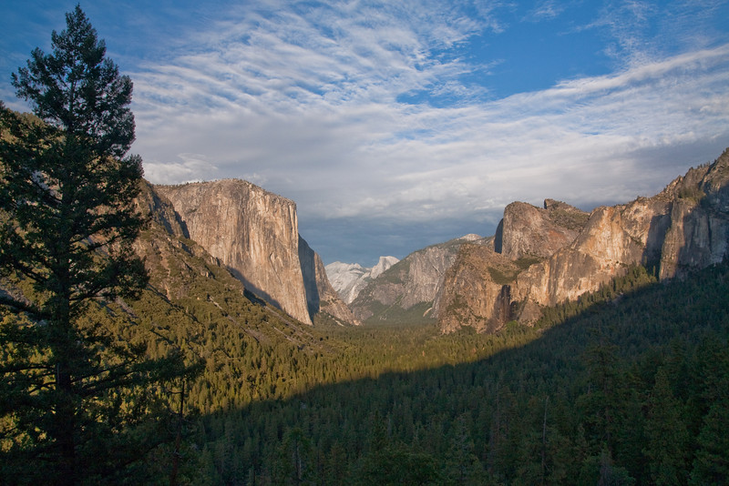 Late afternoon view of the Yosemite Valley from the Tunnel Lookout viewpoint. Half Dome and Cloud's Rest are in the far distance.