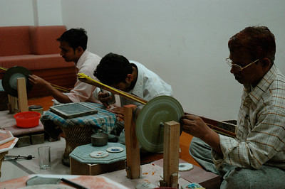 Agra: marble-inlay craftsmen using traditional hand tools.