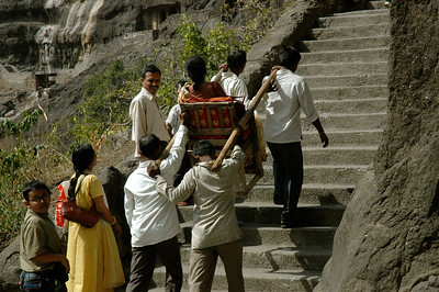 Ajanta: for a fee, you can hire a chair to carry you up the steps.