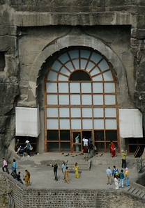 Ajanta: distant view of cave 10; modern screening protects entry.