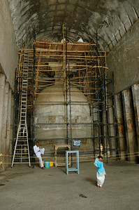 Ajanta: Inside Cave 10, the stupa is under scaffolding used by conservators at top.