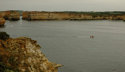 This boat shows the scale of this place. Australia Great Ocean Road.