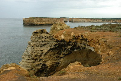 The land is limestone, easily worn by the seas of the South Ocean. Australia Great Ocean Road.