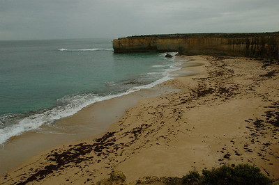 Tucked within rocky headlands are quiet beaches. Australia Great Ocean Road.