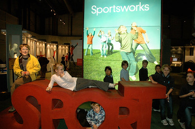 Kids at a augmented-reality sports exhibit, science museum, Melbourne, Australia.