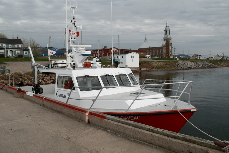 Canadian Coast Guard boat and the main town Church in the background.