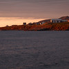 The sun has set behind Cheticamp island but the far peninsula is still bathed in the soft orange light.