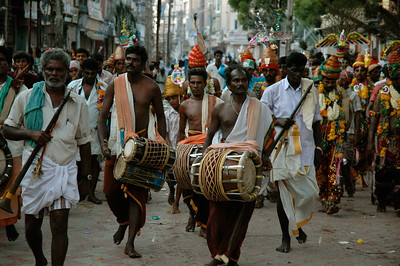 I'm standing in middle of the street as a band marches by. ('Chitirai Thiruvizha' in Madurai.)