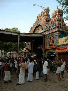 Nearby, a band is playing and people are dancing ('Chitirai Thiruvizha' in Madurai.)